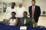"""Steven Camara (bottom right) on """"Signing Day."""" (Mark Brock)"""